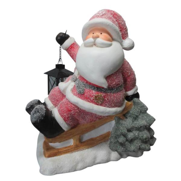 Julemand med fyrfadsstage havedekoration